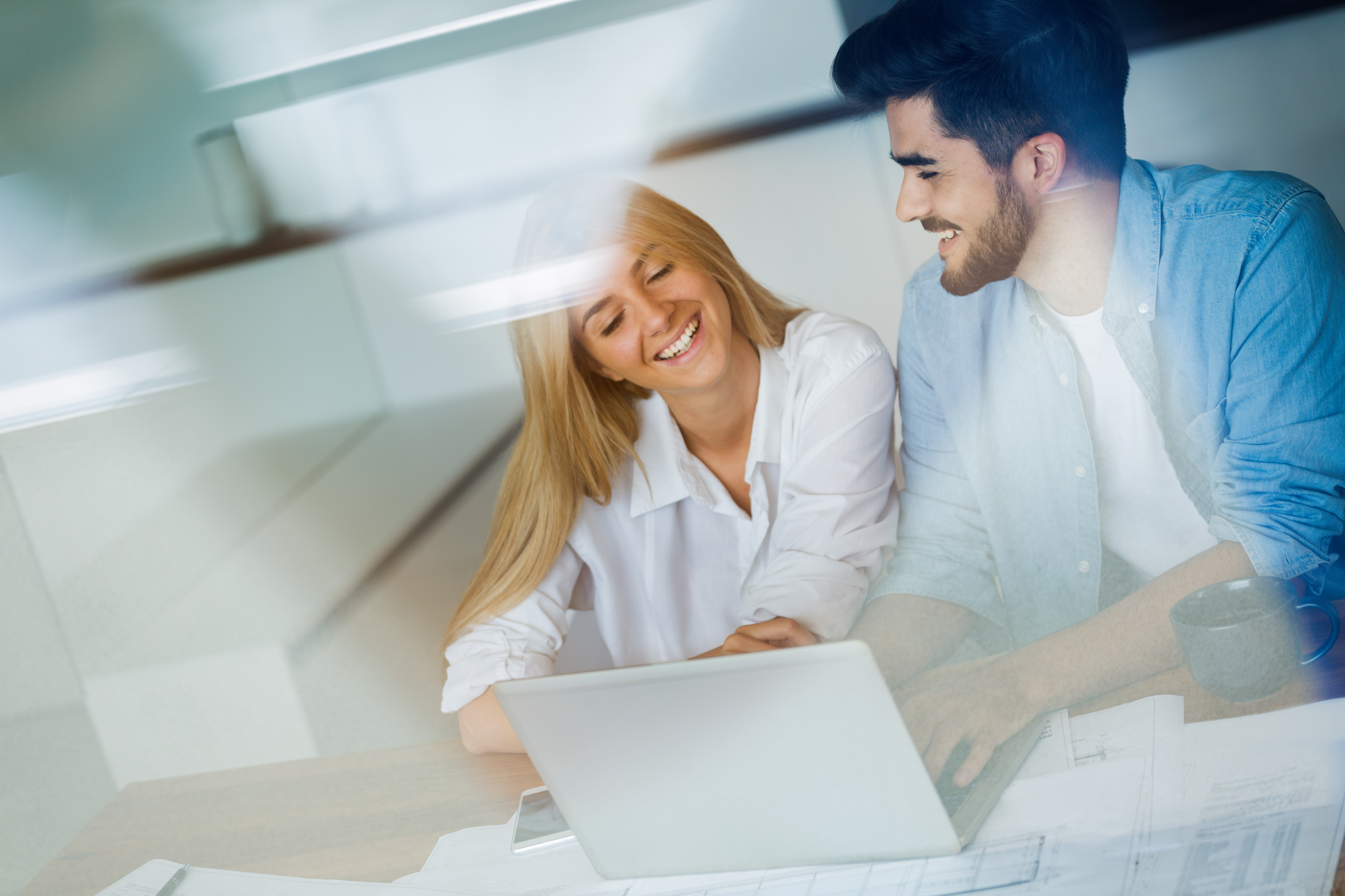portrait-of-a-cheerful-young-couple-calculating-th-SUDNPRM